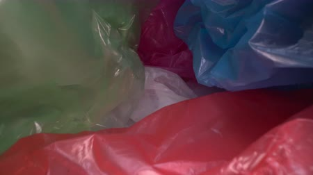 packet : Dolly shot through disposable plastic bag background. Transparent, reusable plastic waste. Plastic recycling, environmental issues Stock Footage