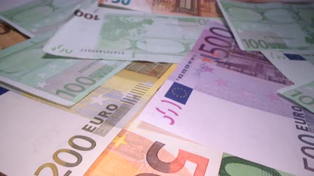 top ten : Dolly shot of euro bank notes background stacked on top of each other. Gliding through Euro money banknotes, pile of money, cash, stack of bills. Investing money, savings Stock Footage