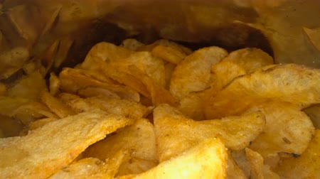 plachtit : Inside the potato chips bag. Opened pack of original taste delicious potato crisps. Fast food and unhealthy eating concept