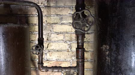 grzejnik : Rusty boiler room pipes. Old metal boiler generating heating and delivering it to home through pipeline. Hot water or gas is being delivered with this system