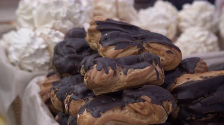 bafat : Bunch of eclairs pastry covered with chocolate stacked on top of each other at the food market