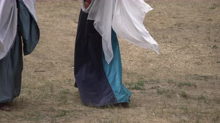 コロニアル : Woman dancing traditional dance on the ground in rural environment outdoors. People perform for the crowd in a village festival