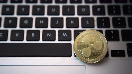 mijnwerker : Circle Ripple coin on top of computer keyboard buttons. Digital currency, block chain market, online business