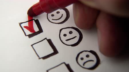 értékelés : Human hand marking smile face, tick placed on excellent check box. Customer service survey, satisfaction symbol