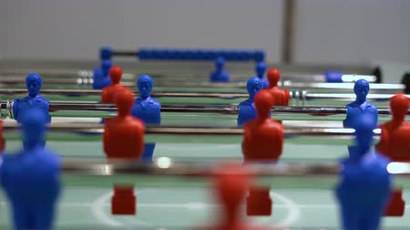miniatűr : Panning view of - foosball, table soccer. Team sport, table football players. Competitive table game