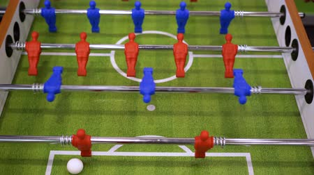 miniatűr : People playing foosball table soccer. Team sport, table football players. Competitive table game
