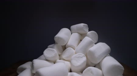 diyabet : Pile of sweet and soft marshmallow. Yummy white sweets on dark background, fast food Stok Video