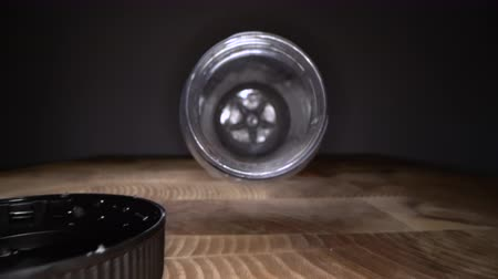 Inside the plastic bottle. Dolly macro shot of camera zooming in empty water bottle on wooden background