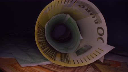 yirmi : Inside the money tunnel. Abstract perspective view of euro back notes rolled in a tube. Saving and investing money