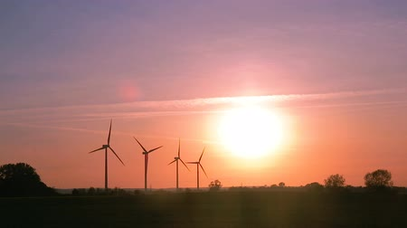 Wind farm on a field during sunset. Sustainable living or energy abstract concept. Vídeos