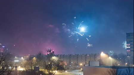 New Years Eve colorful fireworks in residential part of the city time lapse.