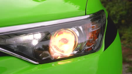 Modern green luxury car healight with low beam and turn signal or blinker. Vídeos