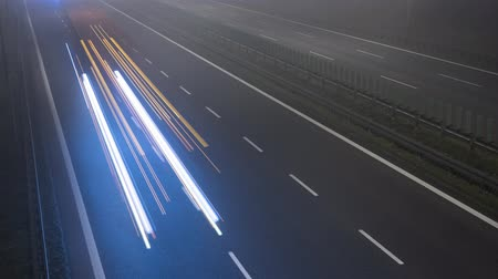 Cars driving fast on a highway. Night time lapse. Business or technology abstract concept. Vídeos