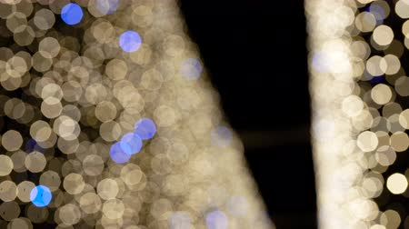 Defocused Christmas or New Years Eve blue and golden lights background. Festive decoration. Vídeos