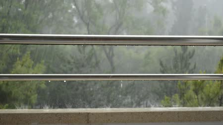 Rain on a railing on stainless steel