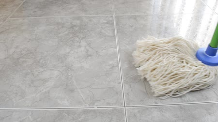 Close up of mop cleaning the floor marble Dostupné videozáznamy