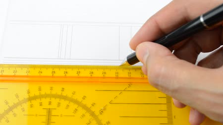 Close up of architect designing a plan of a house