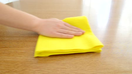 woman cleaning furniture table with yellow cloth Dostupné videozáznamy