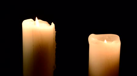 only two candle with flame flare with black background with Low Key