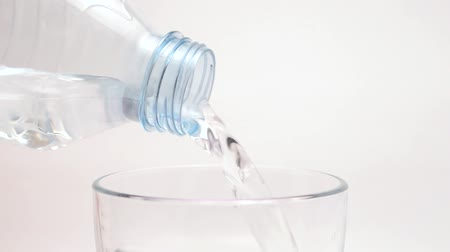 close up of a mineral water being poured into a glass Dostupné videozáznamy