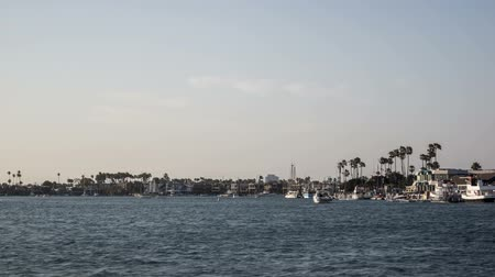 Time lapse video of fast moving boats at Alamitos Bay in Long Beach, California Wideo