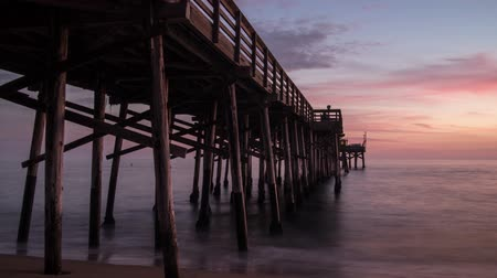 Time lapse video of The Balboa Pier in Newport Beach, California at sunset
