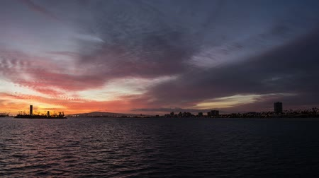 Time lapse of sun setting at The Port of Long beach, California