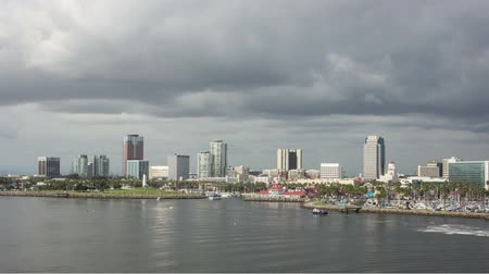 Seamless loop time lapse video of Shoreline Village and downtown Long Beach with fast moving clouds and passing boats