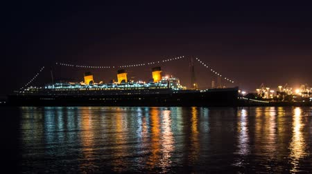 May 2014, Long Beach, California. The Queen Mary Ship in Long Beach Harbor time lapse video with fast moving clouds and passing boats Wideo