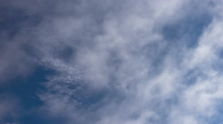 Time lapse video of seamless looping clouds against deep blue sky