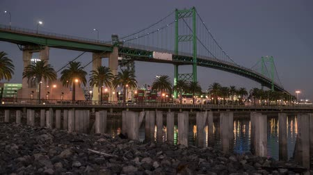 Time laspe video of moon rising over the Vincent Thomas Bridge in the Port of Los Angeles