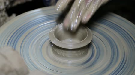 potter wheel : hands on a piece of pottery made of clay