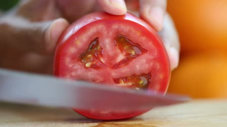 food preparation : Hand slicing a red tomato with a knife, close up, HD 1080P Stock Footage