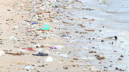 lixo : HD: Garbage on a sandy beach - environmental pollution, 1920x1080 Stock Footage