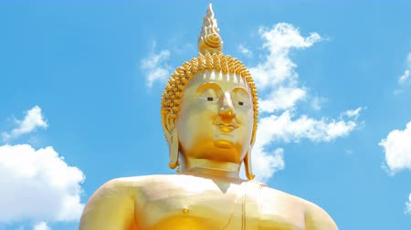 heykel : 4K: Time-lapse, Buddha statue on cloud and blue sky at temple of Thailand, High quality, Ultra HD, 4096x2304