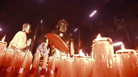 budha : HD: Dolly, Buddha statuettes with candles in temple, 1920x1080