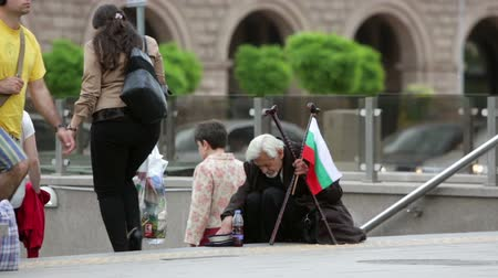 feiúra : Sofia Bulgaria  May 15 2015: A homeless beggar is begging at a subway underpass entrance in the center of Sofia. Years after joining the EU Bulgaria is still struggling with increasing poverty among its population.