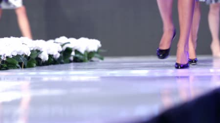 supermodel : Female models walk the runway . Legs and shoes only. Stock Footage