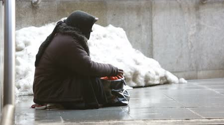 sofia : Anonymous woman is begging in the street of Sofia. Bulgaria is the poorest country in the European Union. HD.