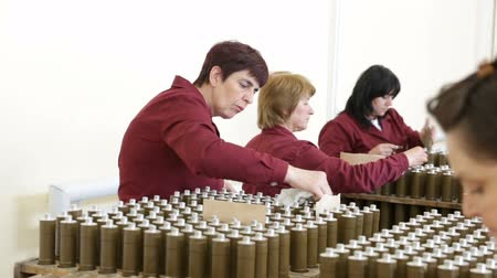 munitions : Sopot, Bulgaria - May 17, 2016: Female workers are checking explosive elements of anti tank rocket-propelled grenades (RPG, bazooka) near the assembly line in a munition factory. Stock Footage