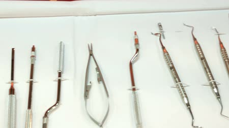 Dental instruments for stomatology practice. Tweezer, carver, wiper, drill, pincers, scraper, remover.Panning.