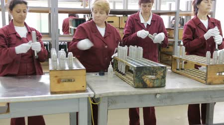 anti war : Sopot, Bulgaria - May 17, 2016: Arsenal women workers are producing weapons detonators in one of Bulgarias arms factory. The facility produces and assembles rocket-propelled grenades (RPG), RPG-7 launchers, RPG war heads, detonators, land mines and other Stock Footage