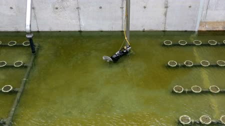 clarifier : Sludge Recirculation Clarifier Solid Contact Sedimentation Tank. Green dirty water. Wastewater treatment plant. Stock Footage