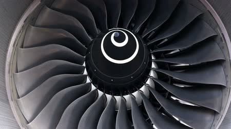 Airbus A380 airplanes engine closeup on a runway at an airport.