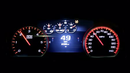 kph : Modern light car mileage (dashboard, milage) isolated on a black background. New display of a modern car. RPM and MPH. Stock Footage