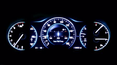 mph : Modern light car mileage (dashboard, milage) isolated on a black background. New display of a modern car. RPM, Fuel indicator and temperature. Sport. mph.