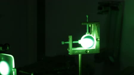 light amplification : Powerful industrial green laser equipment in a laboratory for physics research. Solid State Physics lab. Light amplification by stimulated emission of radiation (LASER).