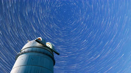 perseids : Astronomical observatory under the night sky stars. Blue sky with hundreds of stars of the Milky way. Stock Footage