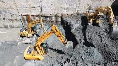 bagger : Sofia, Bulgaria - 25 April, 2017: Excavators dig at a construction site of a street and a subway. Baggers transport dirt to a higher level to make room for the subway digging machine.