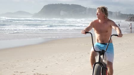 Bike riding on the ocean shore gold coast Australia background